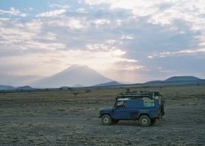 Crossing recent cooled lava flows at the foot of  the volcano Ol Doinyo Lengai in Tanzania